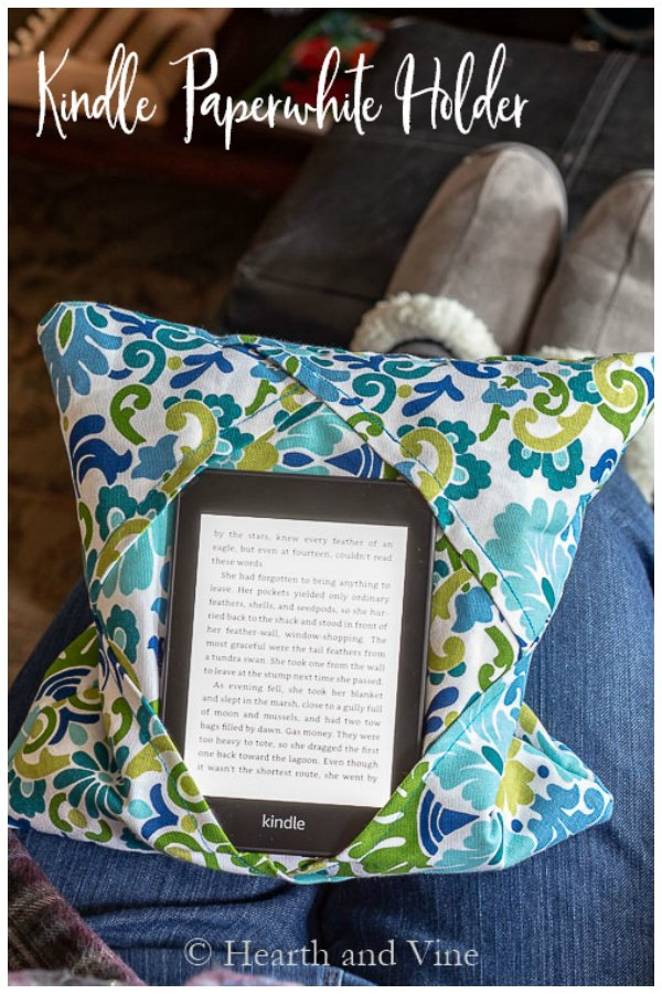 Kindle holder on lap with text