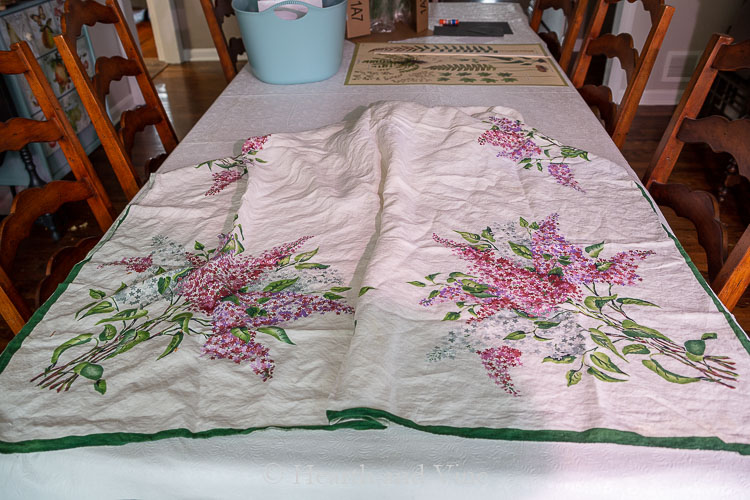 Old linen table cloth with lilacs