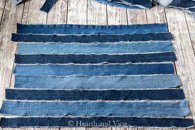 Horizontal strips of denim in different shades of blue