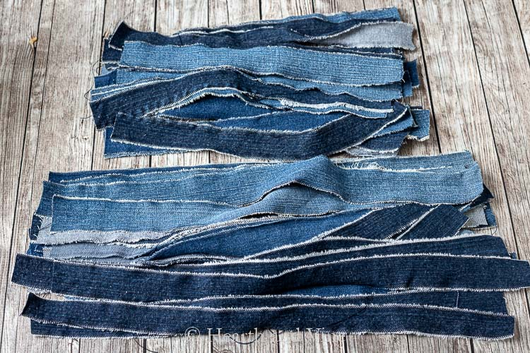 Strips of denim from old blue jeans