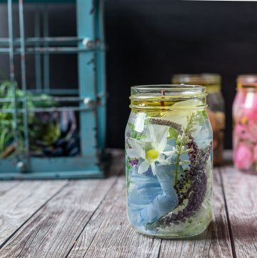 Mason jar oil candle with blue flowers