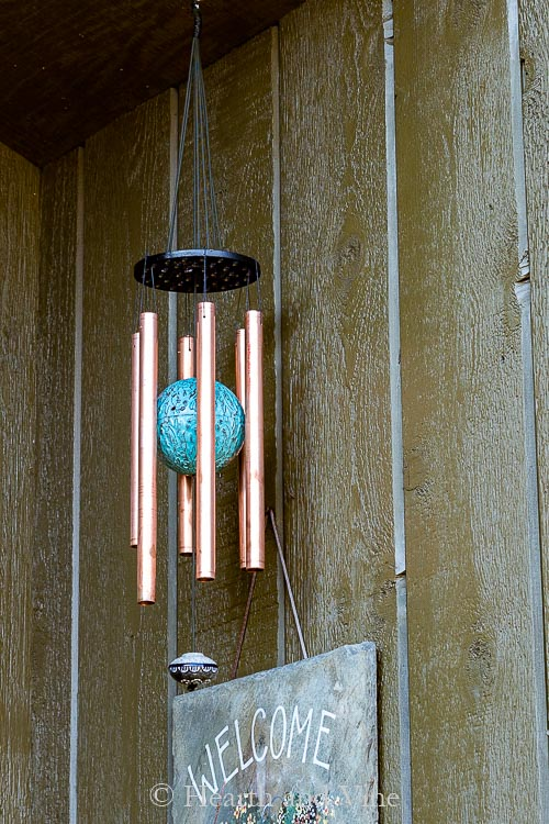Copper wind chimes hanging by front door