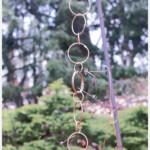 Rain chain hanging from a shephard's hook