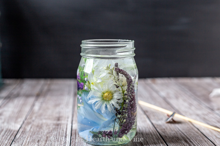 Mason jar with artificial flowers and water