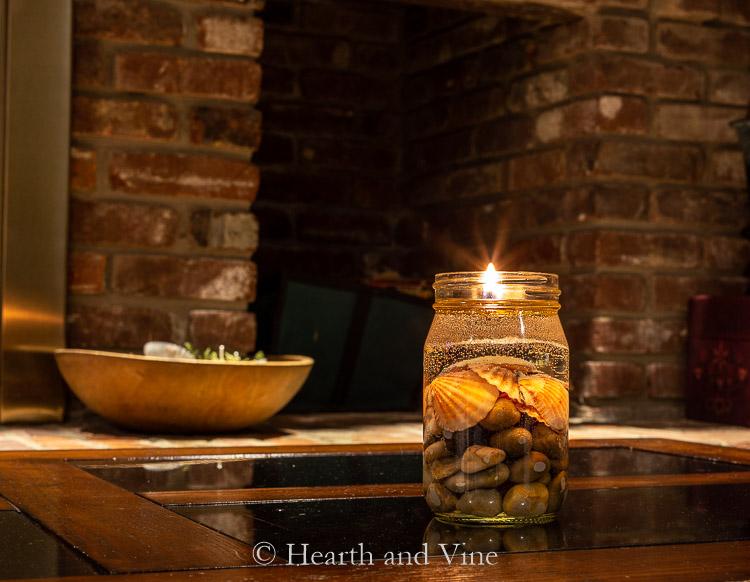 Mason jar oil lamp glowing in the dark