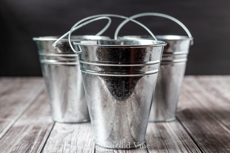 Shiny metal pots with handles