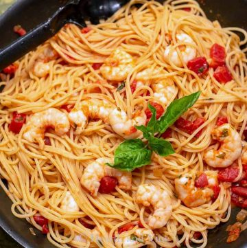 Shrimp and tomato pasta in skillet