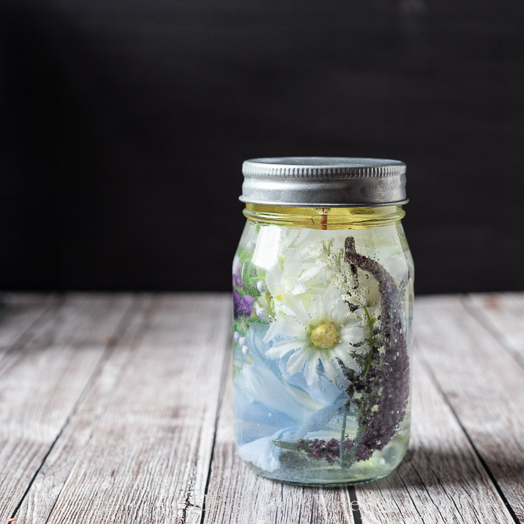 Blue floral mason jar oil candle with galvanized lid