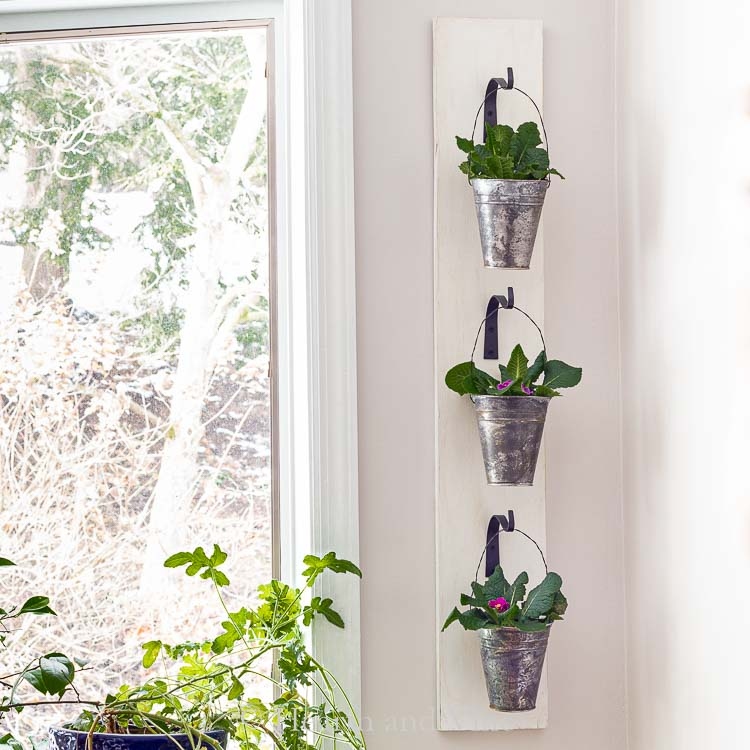 Hanging wall planter with galvanized pots