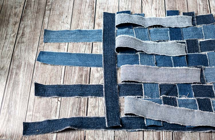 Weaving strips of denim together to make placemat
