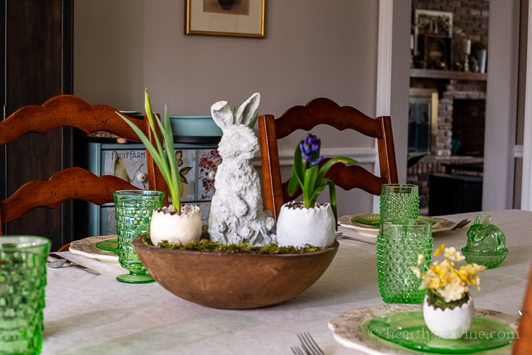 Easter centerpiece dough bowl with ceramic bunny, eggs, moss, and live flowers
