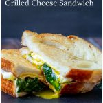 Grilled cheese with spinach, bacon and egg