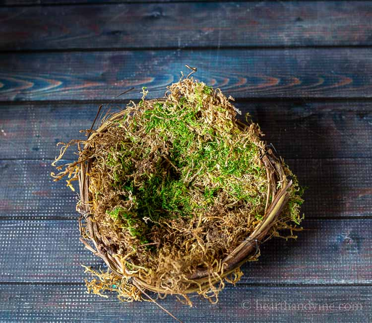 filler and moss in grapevine basket