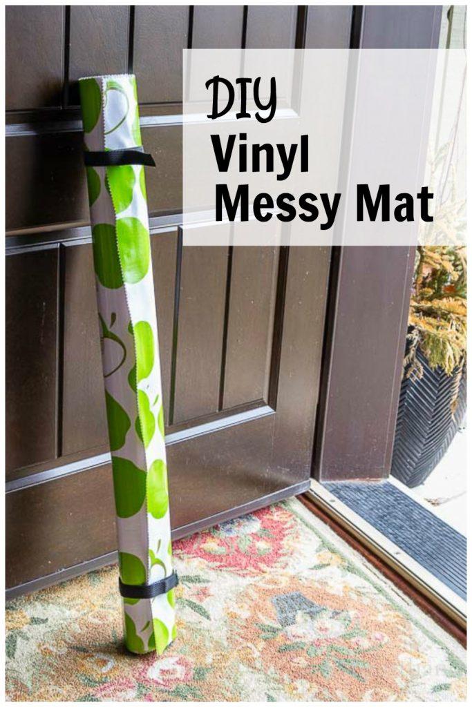 Vinyl mess mat leaning on door