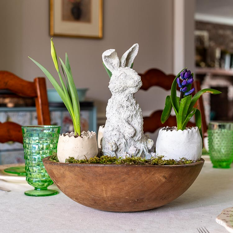 Easter bunny, eggs, flowers in dough bowl