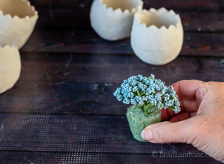 Artificial flowers in foam