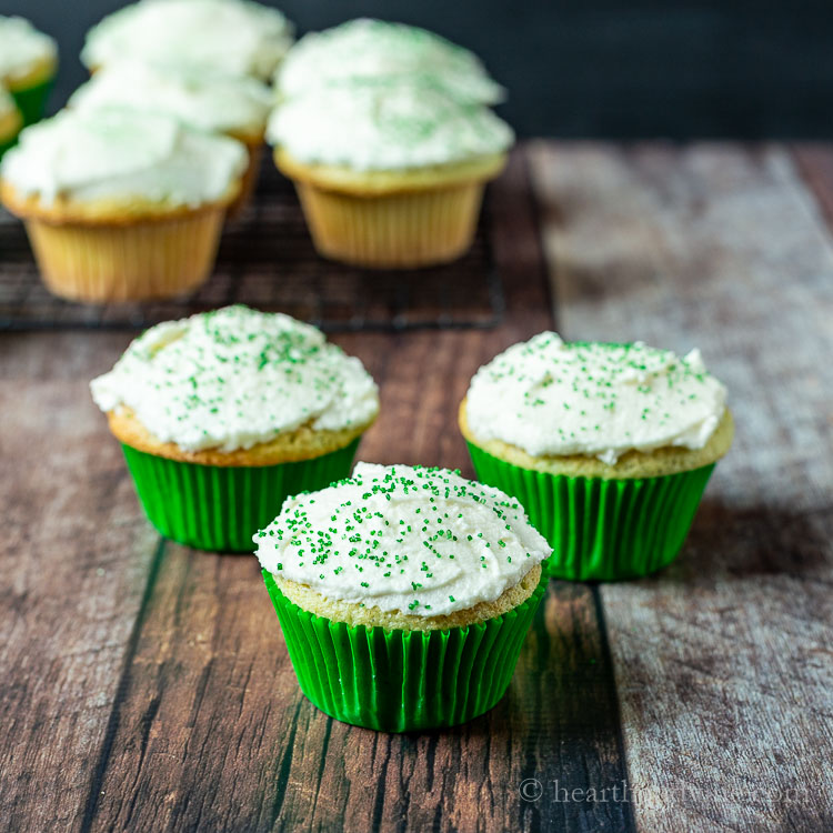 Three cupcakes with green sprinkles