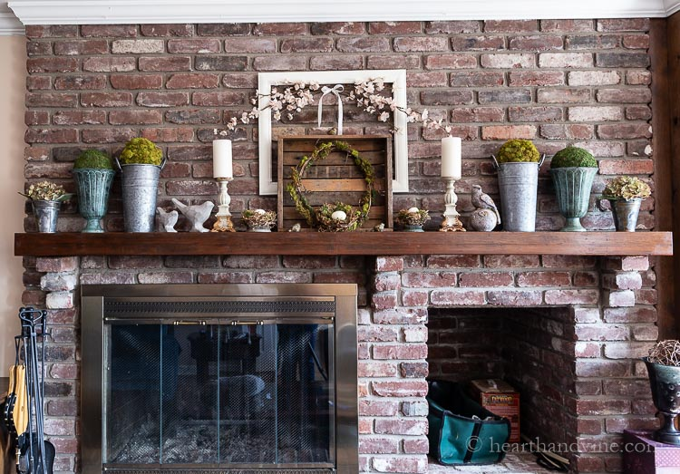 Full view of spring decorated  mantel