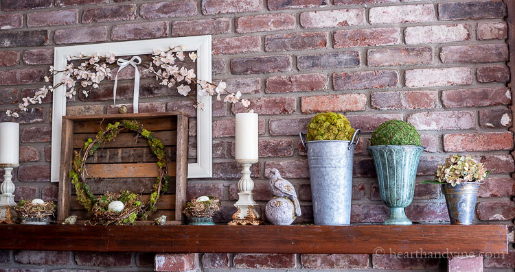 Right side of spring mantel with natural decorations