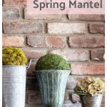 Pail and urns with moss ball on mantel.