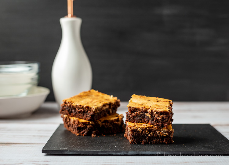 Cut brownies stacked on a platter