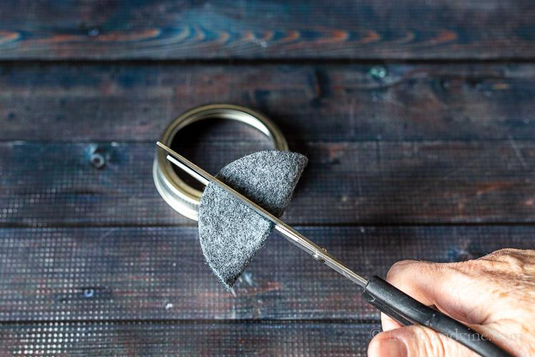 Scissors cutting slit in felt circle