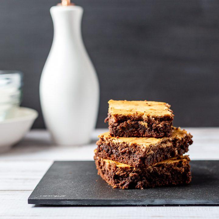 Chocolate cheesecake brownies stacked