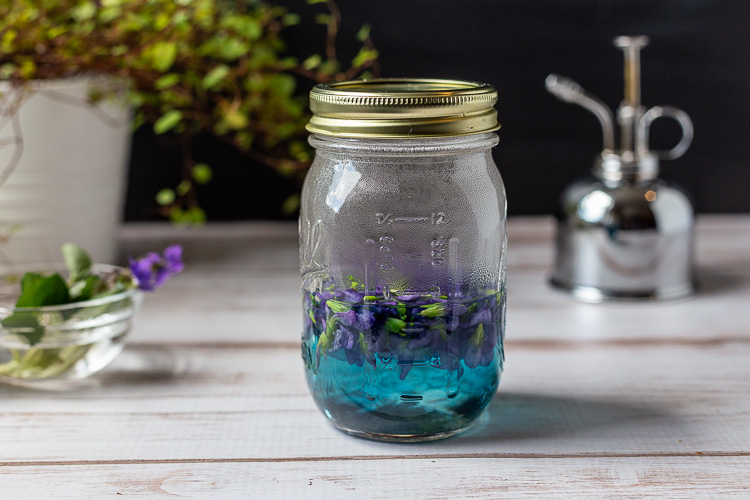 Violets in mason jar with boiling water