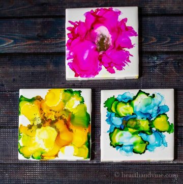 Three ceramic tiles with alcohol ink designs