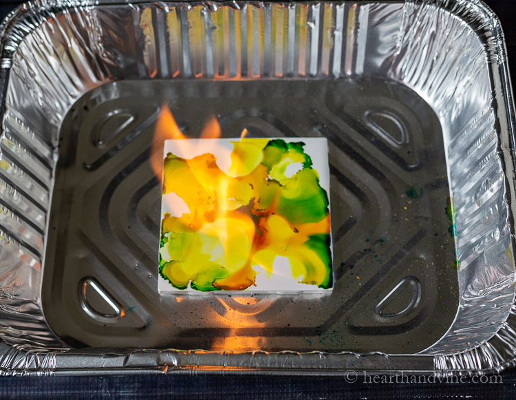 Setting alcohol ink tile on fire.