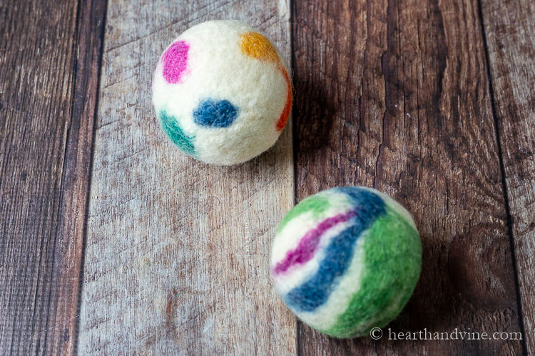 Two colored wood dryer balls