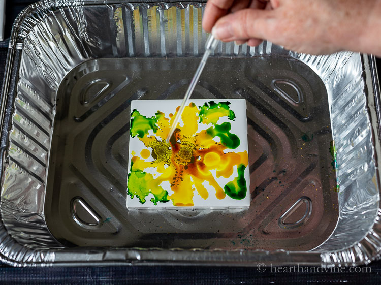 Add in rubbing alcohol ink to the tile.