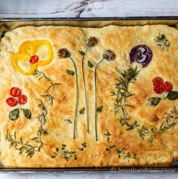 Focaccia bread with vegetable art on top