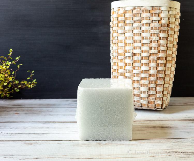 Block of Styrofoam and whitewashed basket.