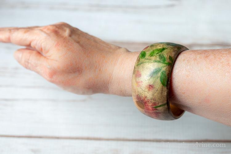 Floral wood bracelet on wrist.