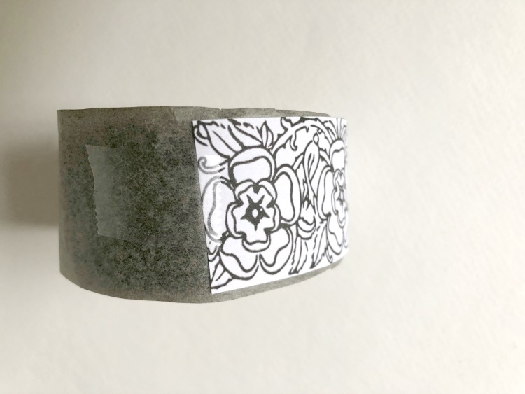 Carbon paper and floral print on bracelet