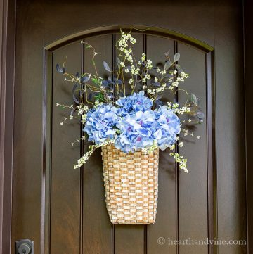 Summer floral basket wreath on front door.