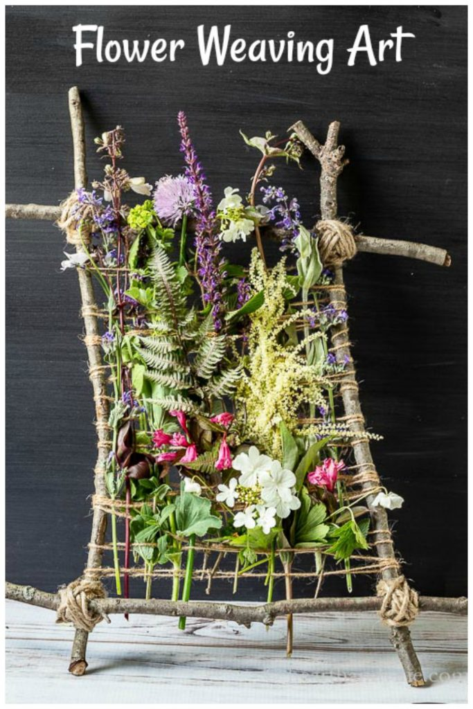 Flowers weaved into twig and twine frame.