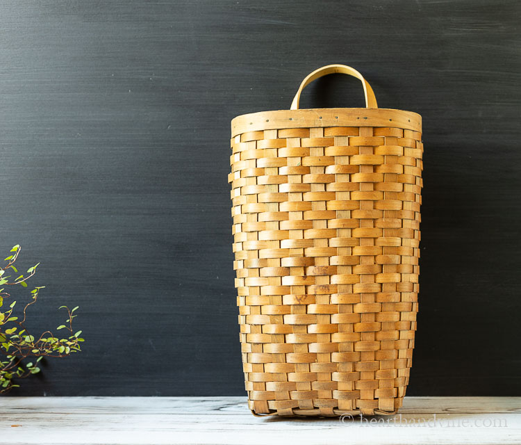 Old tall orange wood basket