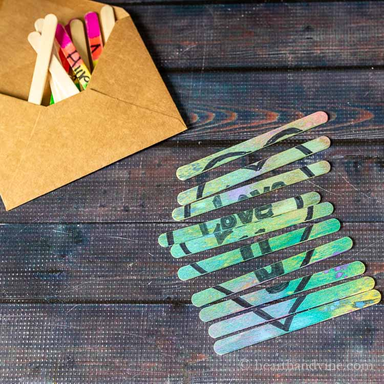 Craft stick puzzle and envelope with more sticks.
