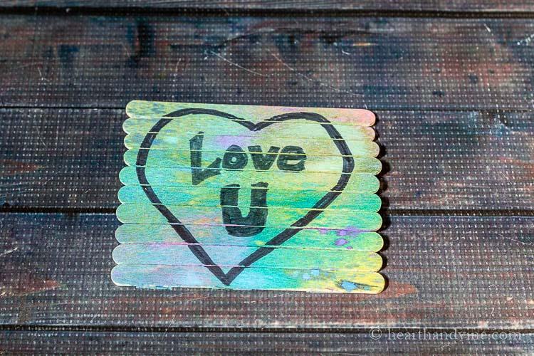 "Craft stick puzzle with message, ""Love U"""