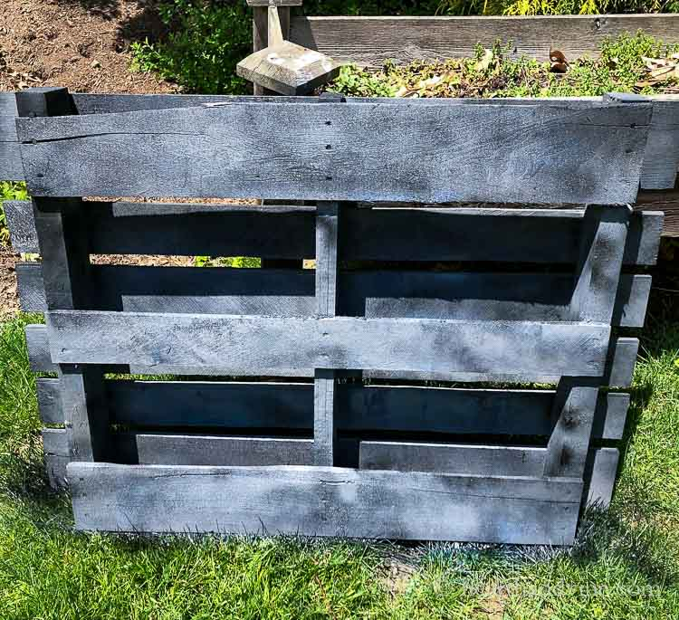 Spray painted wood pallet in shades of gray and black