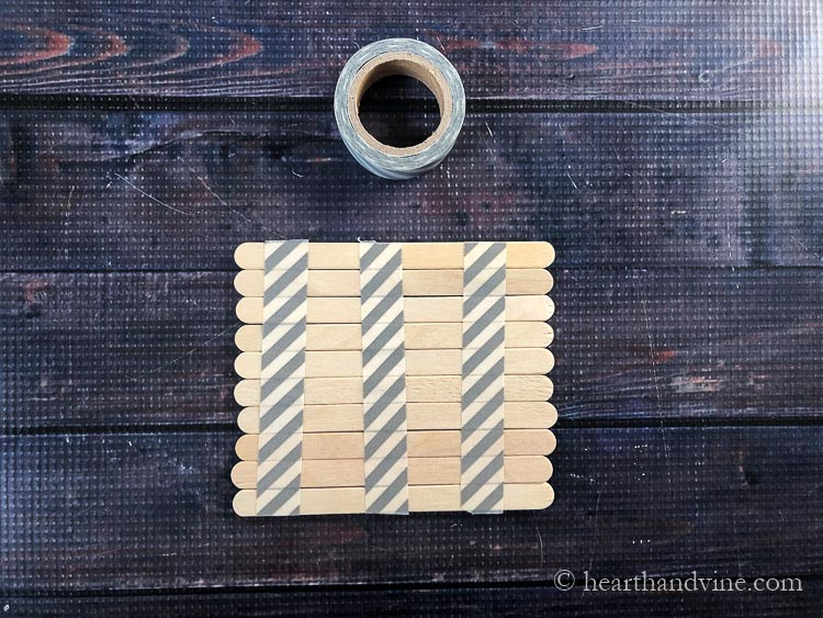 Taping craft stick together