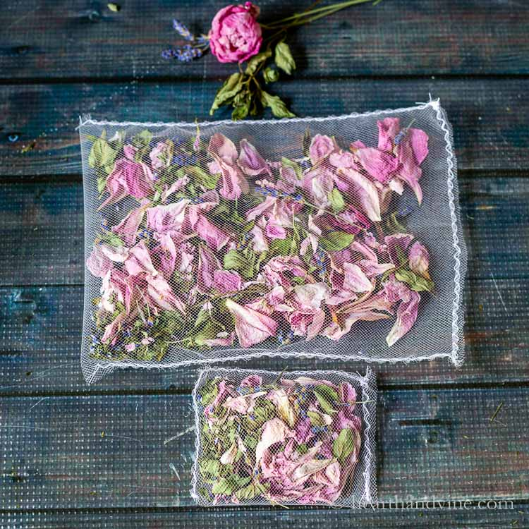 Two homemade floral sachets with peony petals, mint leaves and lavender pieces.