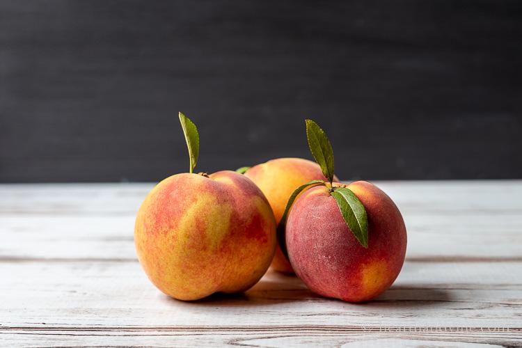 Three fresh peaches.