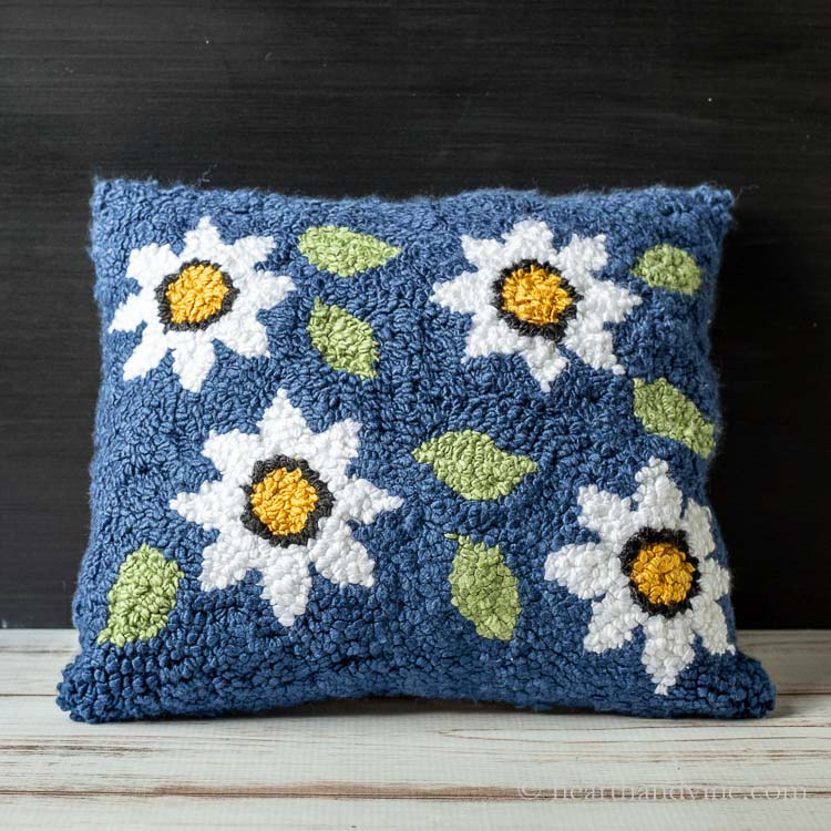 Floral rug hooked pillow.