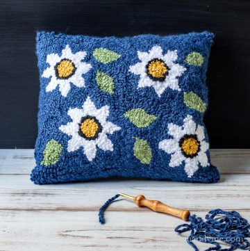 Punch needle rug pillow with floral pattern