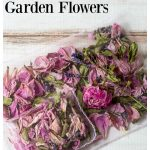 Two homemade floral sachets stacked on top of each other with dried flowers on white background.