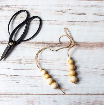 Two wood bead diffusers and a pair of scissors