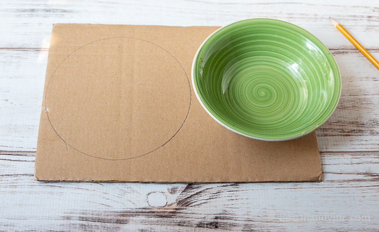 Cardboard and bowl used to trace a circle with a pencil on the cardboard.